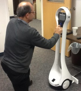 Man with VGO robot