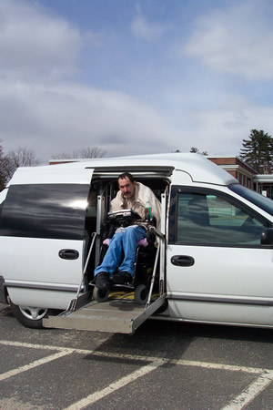 man in adapted van