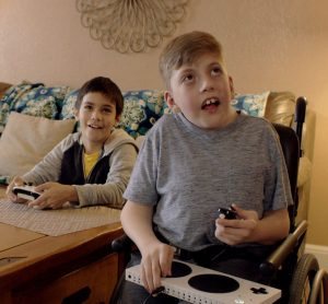 Owen and friend play with Xbox